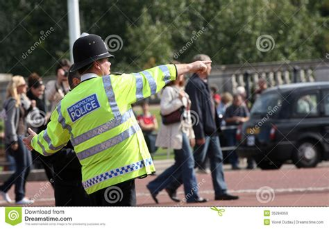 Metropolitan Police Officer Giving Directions Editorial
