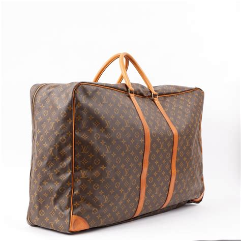 louis vuitton leather travel bag  brown lyst