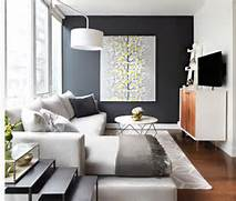 Paint Color For Dark Living Room by Love The Dark Accent Wall And The Little Pop Of Color In The Painting Decor