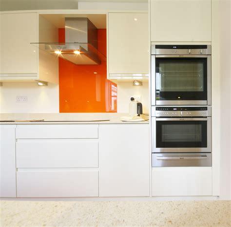 gloss kitchen  striking orange splash  neff
