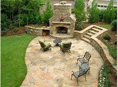after a beautiful stone patio and fireplace backed by