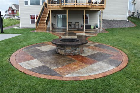 brick home floor plans stained concrete patio with a wrapped pit