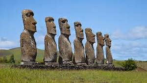 Moai statues stand in the barren landscape of Easter Island. Easter Island (Chile)