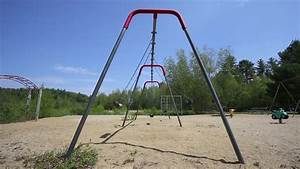 Empty Swing Seats At A Deserted Playground Moving Back And ...