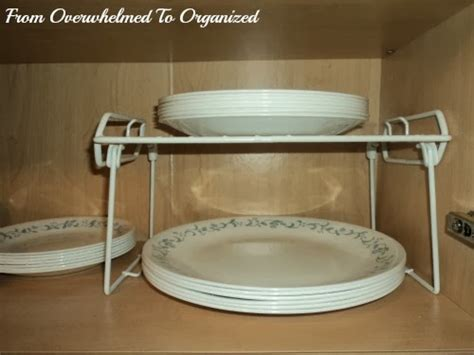 dishes  glasses cupboard organizing tips  overwhelmed  organized dishes  glasses
