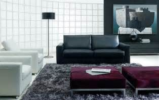 modern living room design with black sofa arch l white sofa grey rug and red bench with sleek