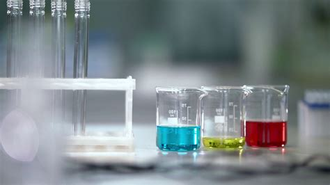glass tube table l lab worker put test tubes rack on laboratory table