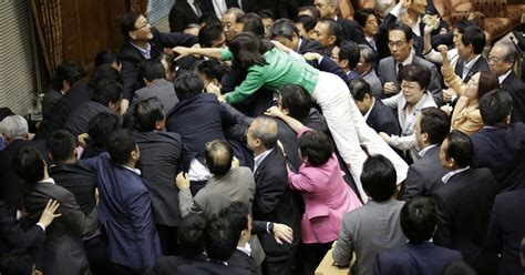 japan military bills provoke scuffling  parliament