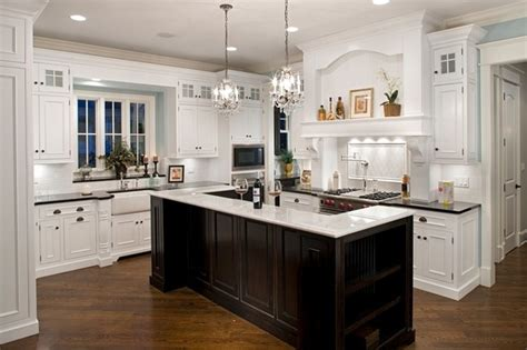 white kitchen cabinets with different color island oakley home builders 2209