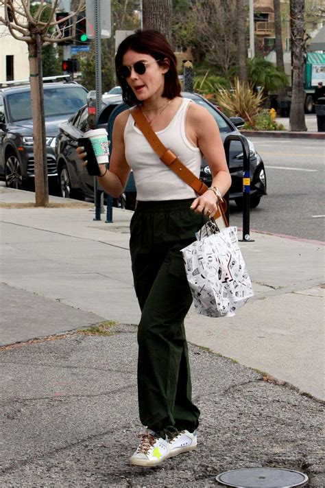 lucy hale looks trendy in a white tank top, green cargo ...