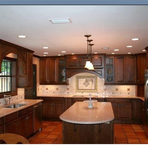 Dark cabinets with terra cotta tile floor   Home