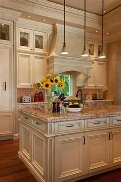 Kitchen with off white cabinets, stone backsplash and