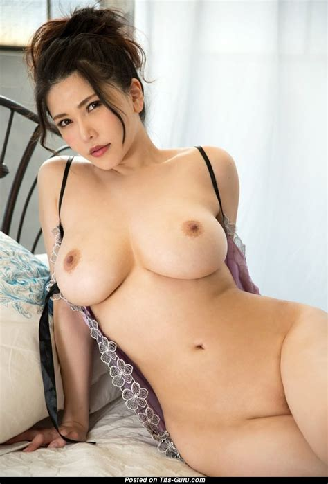 a naked asian woman s tits