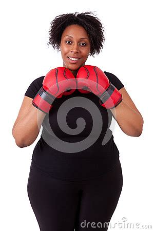 overweight young black woman holding boxing gloves