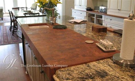 butcher block slab in middle of granite counter