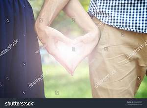 Loving Couple Holding Hands Shape Heart Stock Photo ...