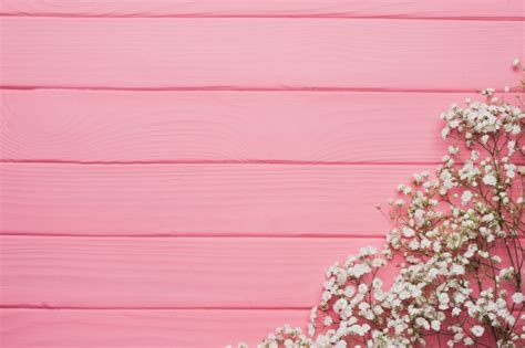 pink wooden background  floral decoration photo