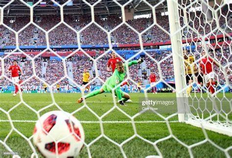 Eden Hazard of Belgium scores Jordan Pickford of England ...