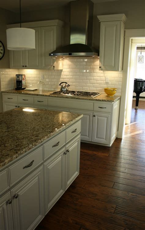 white kitchen cabinets with brown countertops pin by michelle tattari on project ideas brown granite 734 | fd97d6b81a884f8bb61bc2a3f09b790f antique white cabinets dark wood floors