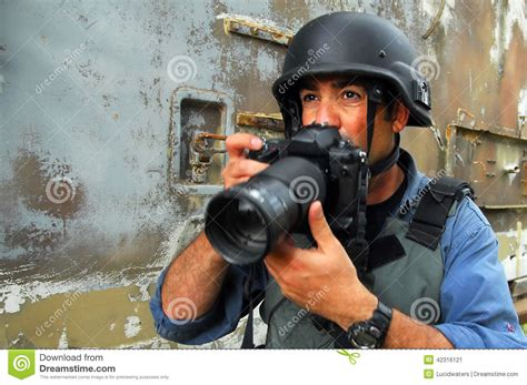 photojournalist documenting war  conflict stock photo