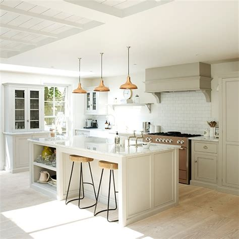 best warm white for kitchen cabinets white kitchen with warm metallic accents white kitchen