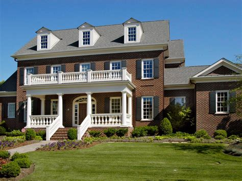 country house with wrap around porch colonial brick house with black shutters hgtv