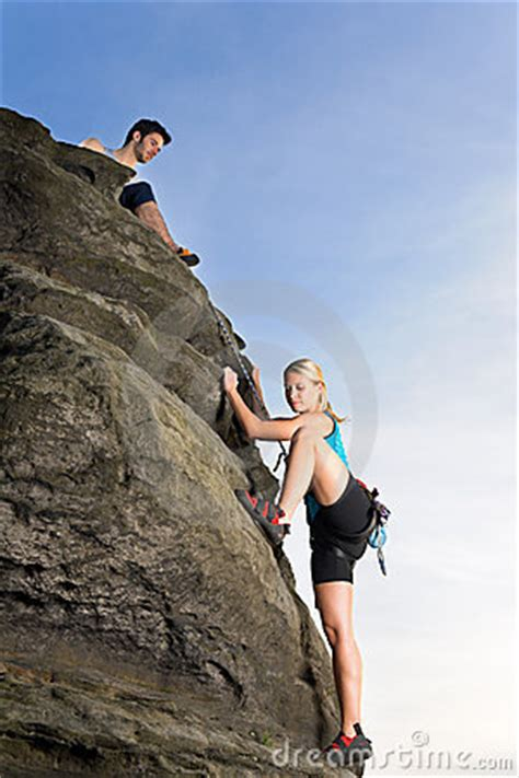 Woman Climbing Rock Man Hold Rope Royalty Free Stock