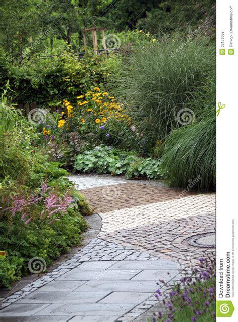ornamental garden path  perennial plants stock photo