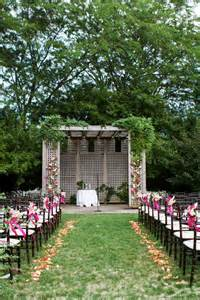 outdoor wedding ceremony with romantic arbor and flowers onewed com