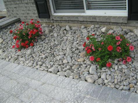 river rock flower bed gardening