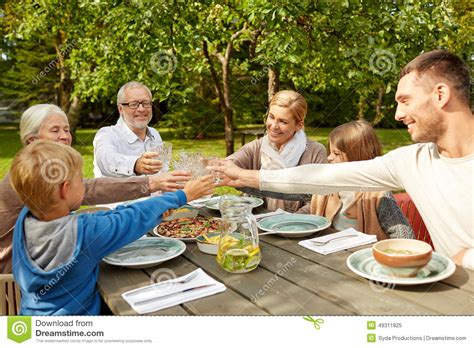 happy family dinner in summer garden stock photo