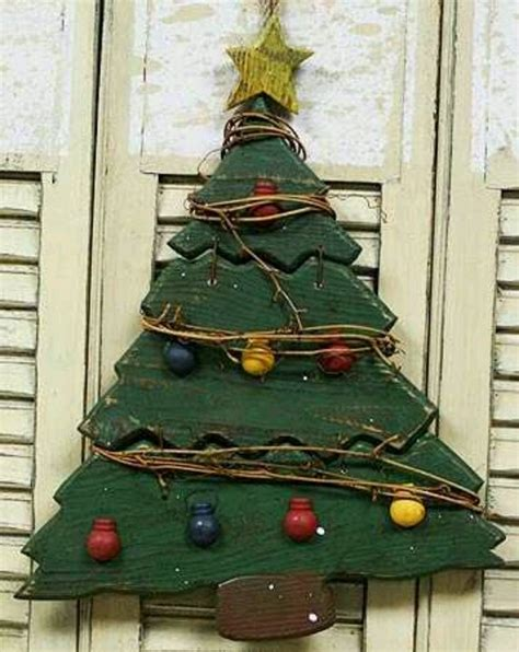 primitive rustic wooden christmas tree garden outside