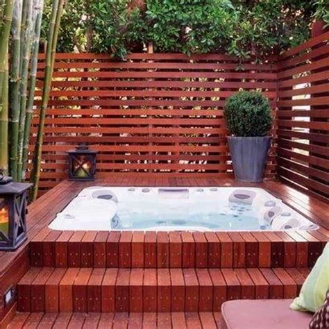 deck design tub with wooden fence and topiary plant