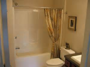 simple basement bathroom with white bathtub plus flower accents curtain design and marvelous