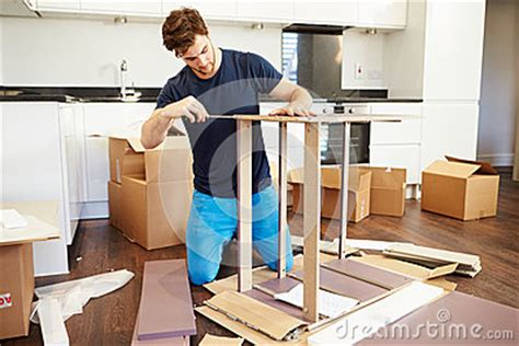 man putting   assembly furniture   home