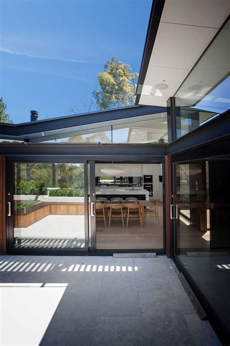 house  stone glass  steel overlooking  yarra river