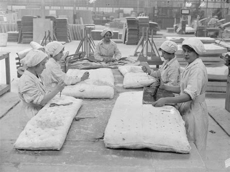 women sewing asbestos  mattresses possibly fire
