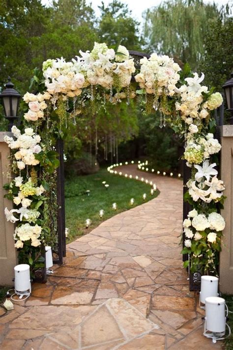 wedding decorations ceremony floral arch and candles for