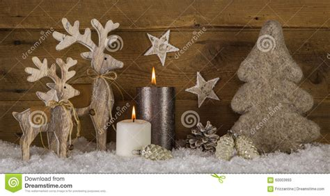 grossiste deco de noel wooden white brown decoration with two burning stock photo image 60003893