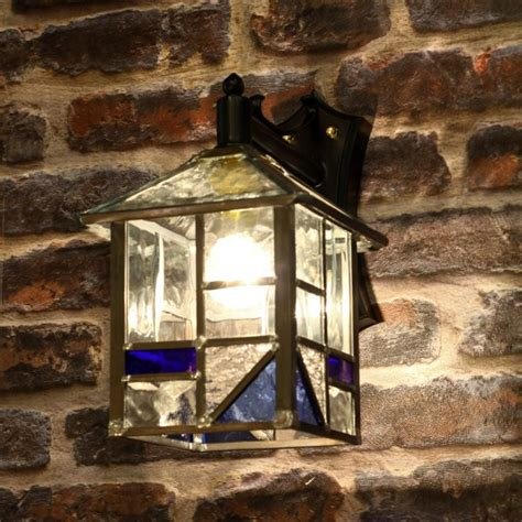 traditional outdoor wall lantern with blue and clear glass
