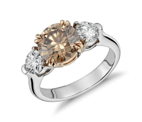 fancy brown three stone diamond ring in platinum and 18k