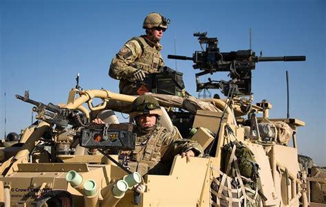 Soldiers In Jackal 2 All Terrain Vehicle On Patrol In