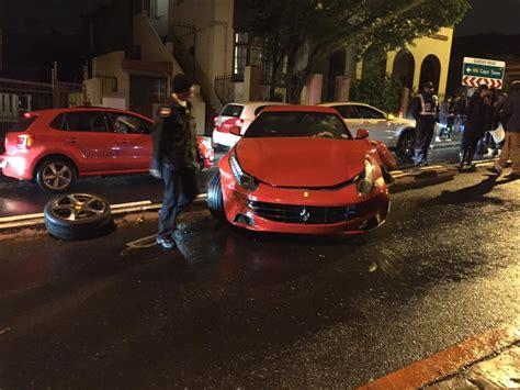 ferrari ff loses front wheel  crashing  wet roads