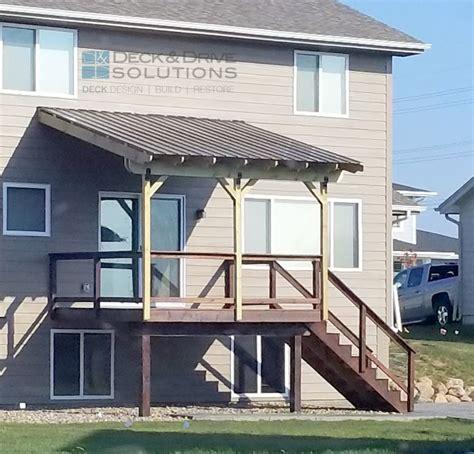 metal roof over deck des moines deck builder deck and solutions