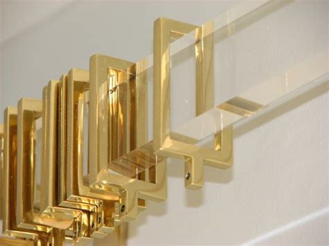 polished brass rings on acrylic curtain rod gold