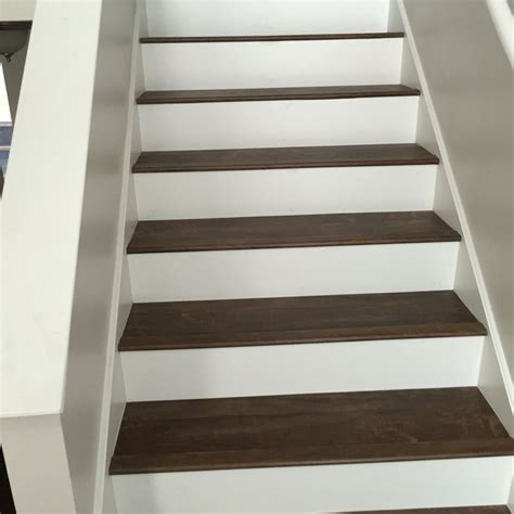 vinyl flooring on stairs luxury vinyl plank on stairs with white risers luxury vinyl plank vinyl tile pinterest