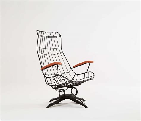 black wire metal rocking chair with original upholstery at