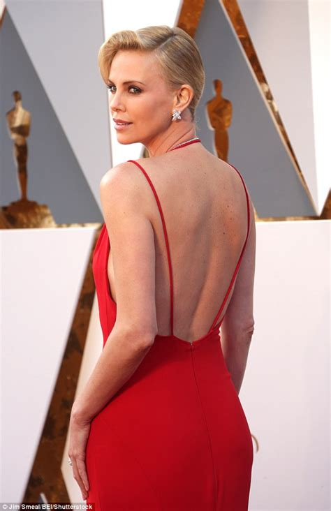 rudimental bikini charlize theron s red gown defied its simplicity at the