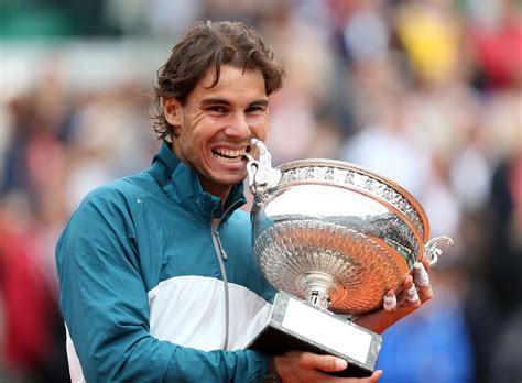 PHOTOS: Rafael Nadal claims 10th title at Roland Garros with victory...