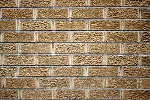 Grandiose faux brick textured wall with brown finished as